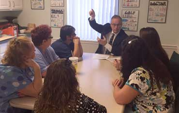 Dr. Schumacher meets with staff members - Geriatric & Medical Specialists Flint Michigan - Nurse Practitioners and Social Work
